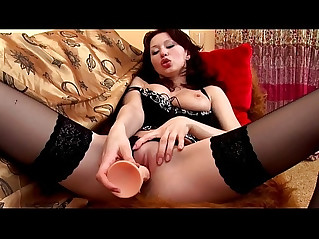 Redhead in thigh highs teases and masturbates