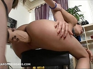 Ninel is bent over and fucked with huge strapon dildo