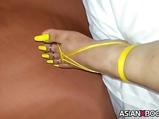 Long yellow asian toenails