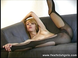 Flexible babe spreading her pussy